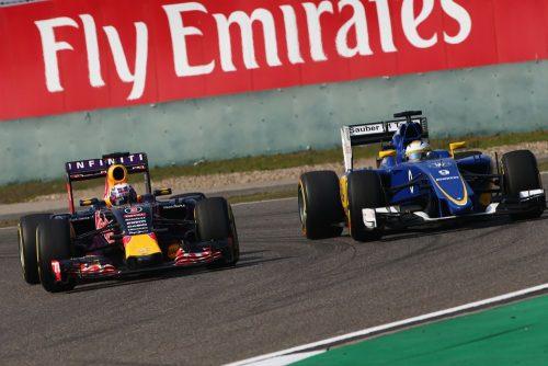 Formula One World Championship 2015, Round 3, Chinese Grand Prix, Shanghai, China, Sunday 12 April 2015 - Daniel Ricciardo (AUS) Red Bull Racing RB11 and Marcus Ericsson (SWE) Sauber C34 battle for position.