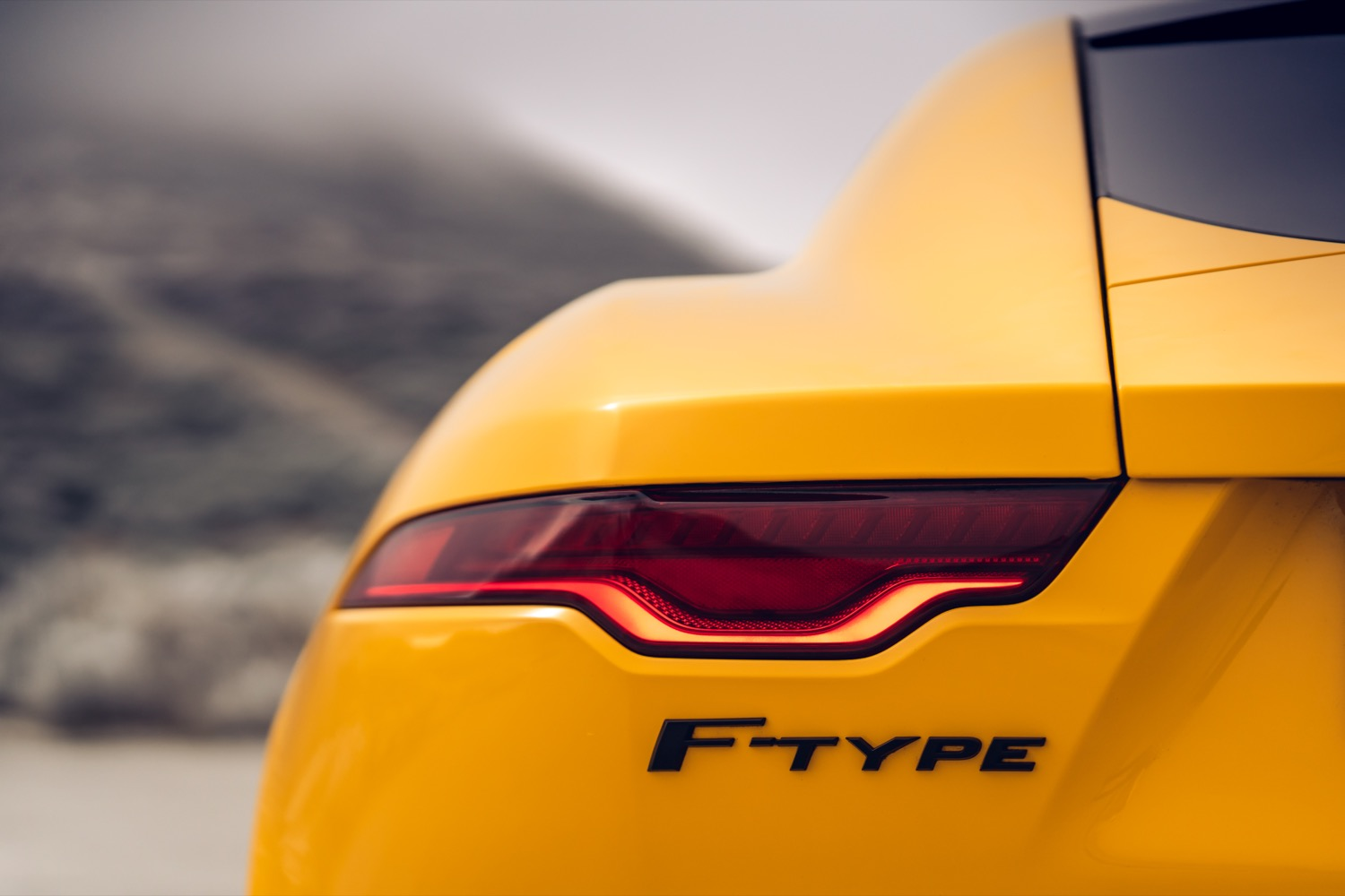 2020_jaguar_ftype_v8_awd_coupe_yellow_test_18
